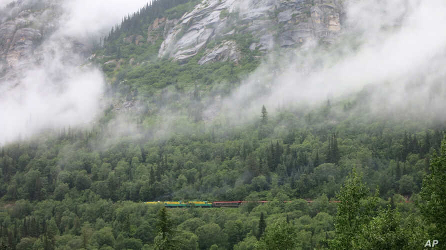 FILE - A train climbs from Skagway toward the White Pass summit in British Columbia, Canada, July 29, 2014. On Monday, an earthquake hit the corner of British Columbia, near the boundary with Alaska.