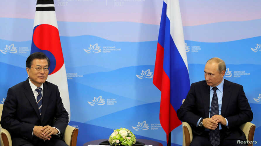 Russian President Vladimir Putin and his South Korean counterpart Moon Jae-in attend a meeting during the Eastern Economic Forum in Vladivostok, Russia, Sept. 6, 2017.