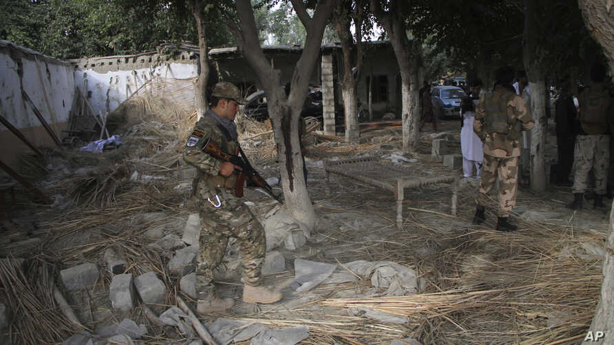 Afghan Security personnel inspect the site of a suicide attack in the Kama district of Nangarhar province, east of Kabul, Afghanistan, Oct. 2, 2018.