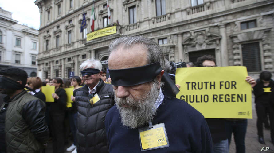 Amnesty International activists stage a flash mob asking for truth about the death of Italian student Guido Regeni, outside Milan's city hall, Italy, April 24, 2016. Egyptian officials have blamed five men for Giulio Regeni's death, but witnesses int...