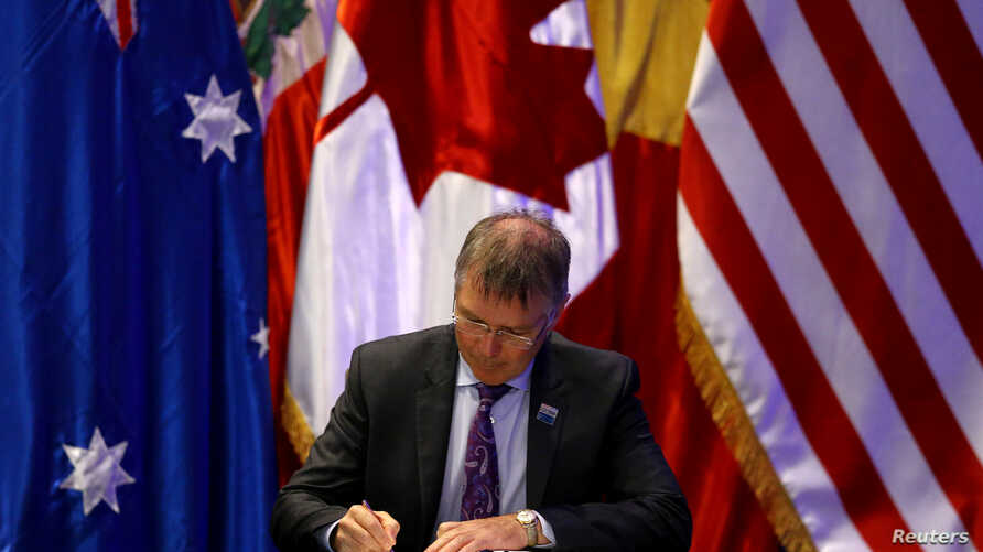 New Zealand's Minister for Trade and Export Growth David Parker signs the Trans-Pacific Partnership trade deal, in Santiago, Chile, March 8, 2018.