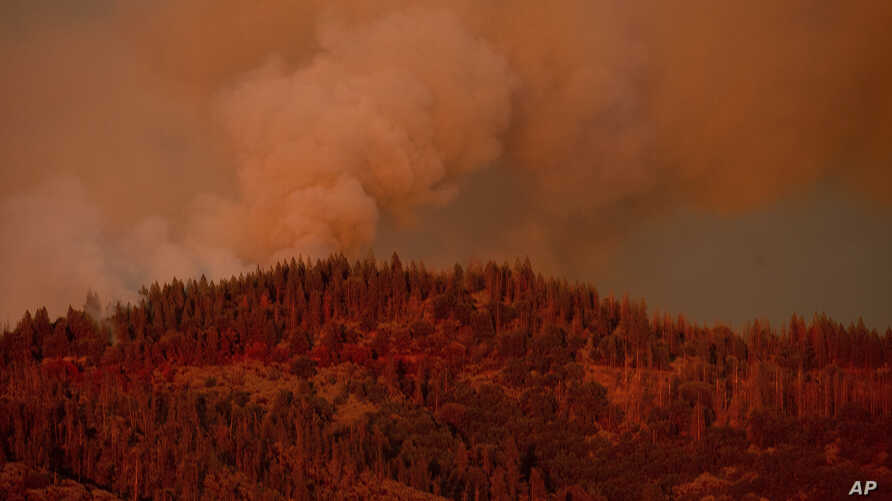 The Ferguson Fire burns along a ridgeline in unincorporated Mariposa County, Calif, July 16, 2018.
