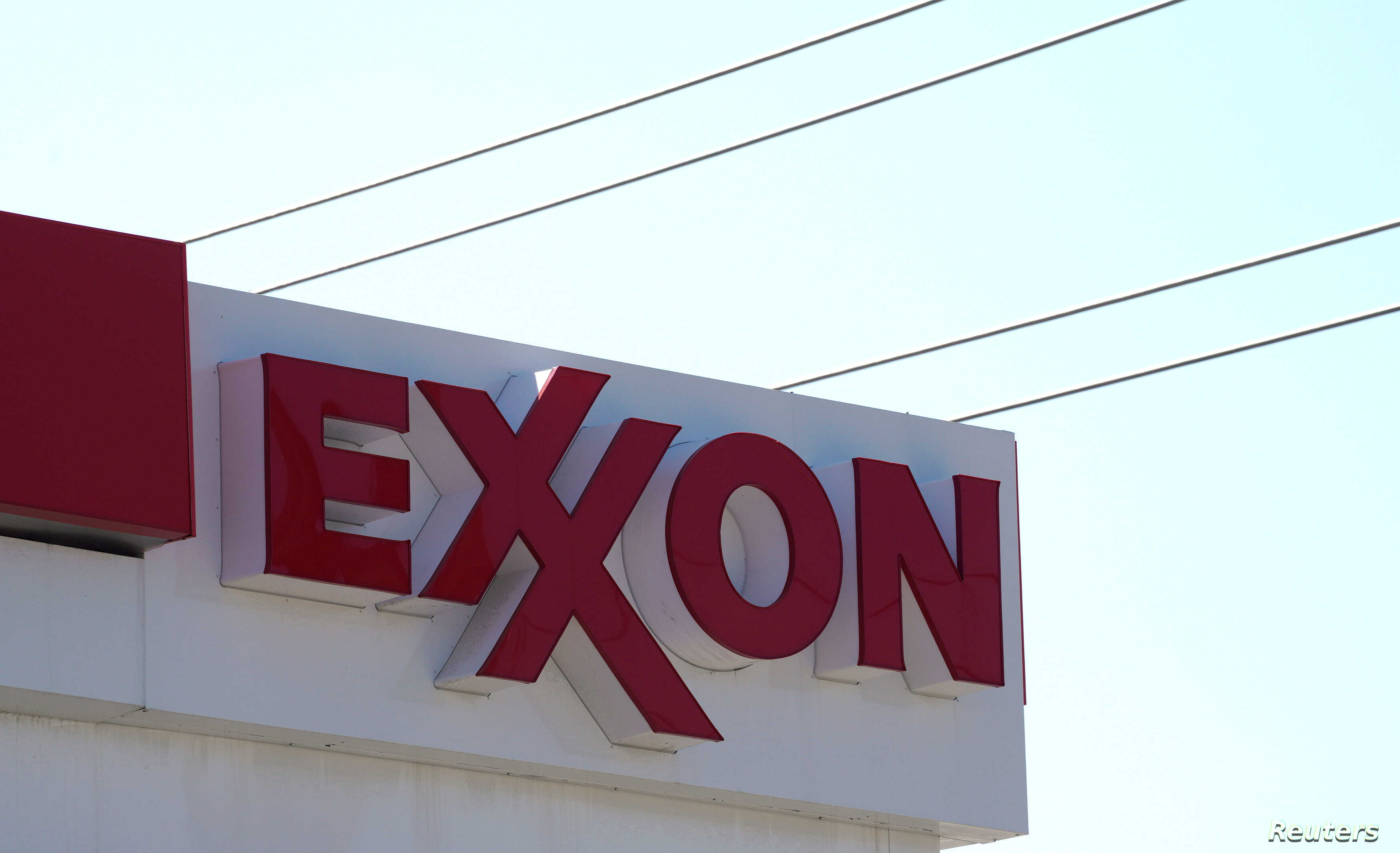 FILE - The Exxon Mobil logo is seen at a gas station in Denver, Colorado, United States.