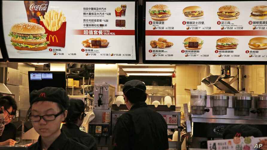 McDonald's restaurants in Hong Kong have taken chicken nuggets and chicken filet burgers off the menu after a U.S.-owned supplier in mainland China was accused of selling expired meat. Food menu is displayed at a McDonald's restaurant in Hong Kong, J
