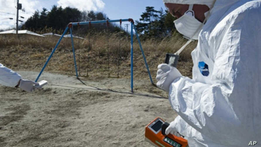 A handout picture released by Greenpeace and taken on March 27, 2011 shows Greenpeace members monitoring contamination levels at Iitate village, 40 km northwest of the crisis-stricken Fukushima nuclear plant, and 20 km beyond the official evacuation