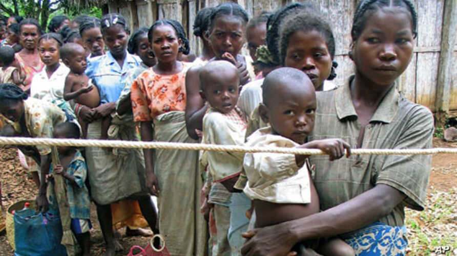 Madagascar mothers line up with their malnourished children to see a doctor in the island's southeast isolated district of Vangaindrano in this picture taken in Jan 2006