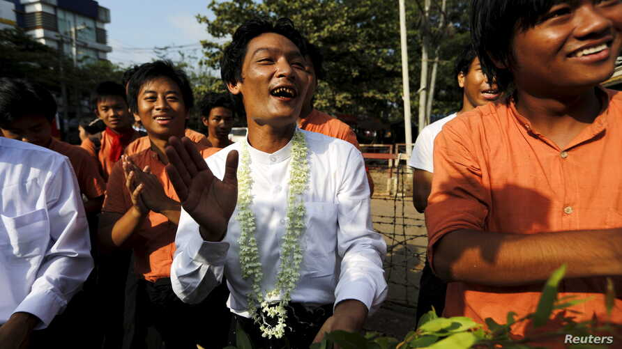 Student activists celebrate outside the prison after being released by the new government's general amnesty in Yangon, Myanmar, April 17, 2016.