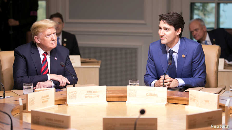 Canada's Prime Minister Justin Trudeau (R) and U.S. President Donald Trump participate in the working session at the G7 Summit in the Charlevoix town of La Malbaie, Quebec, Canada, June 8, 2018.