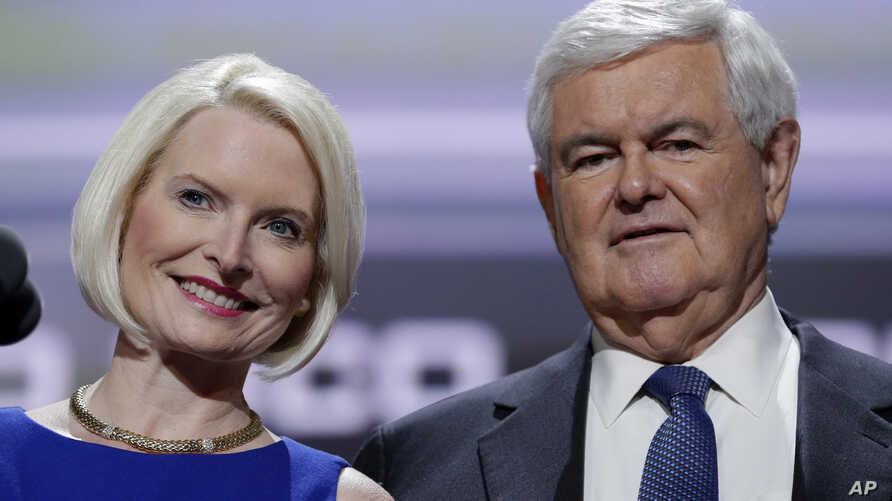 FILE - Former Speaker of the House Newt Gingrich, right, and his wife Callista test the speaking setup before the third day session of the Republican National Convention, July 20, 2016, in Cleveland.