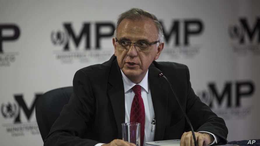 FILE - Ivan Velasquez, commissioner of the United Nations International Commission Against Impunity, CICIG, takes part in a news conference with Guatemala's Attorney General, in Guatemala City, April 19, 2018.