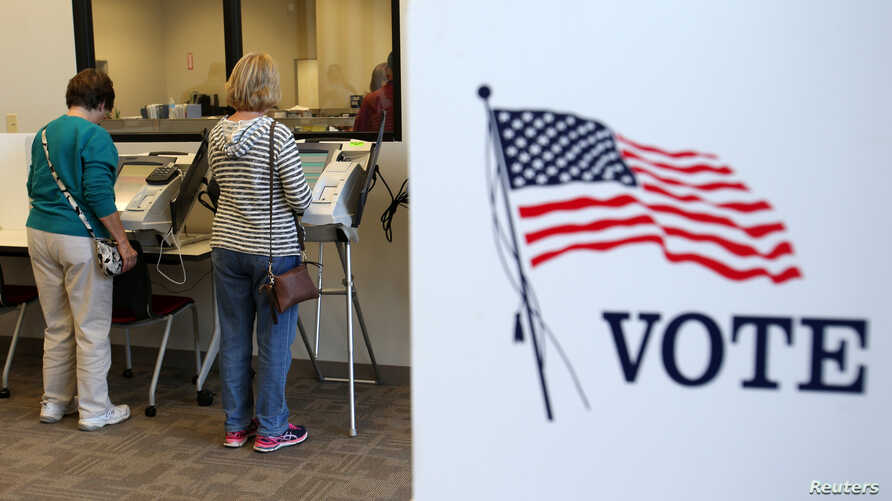 Voters cast ballots as early absentee voting began ahead of the U.S. presidential election in Medina, Cleveland, Ohio, U.S. Oct. 12, 2016.