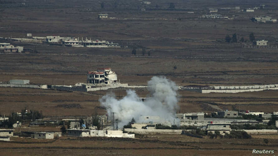 Smoke rises following an explosion on the Syrian side near the Quneitra border crossing, Aug. 29, 2014.