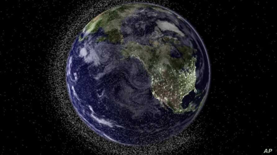 This handout illustration image created by Australia's Electro Optic Systems (EOS) aerospace company shows a view of the Earth from geostationary height depicting swarms of space debris in Low Earth Orbit (LEO), 20 Jul 2010