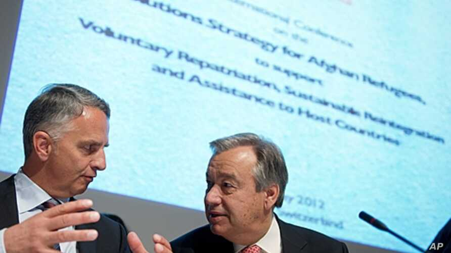 Swiss Foreign Minister Didier Burkhalter (L) gestures next to U.N. High Commissioner Antonio Guterres for refugees at the opening of a two-day International conference on the Afghan refugee situation on May 2, 2012 in Geneva.