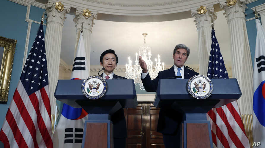 South Korean Foreign Minister Yun Byung-se listens as Secretary of State John Kerry speaks to the media, Oct. 19, 2016, at the State Department in Washington.