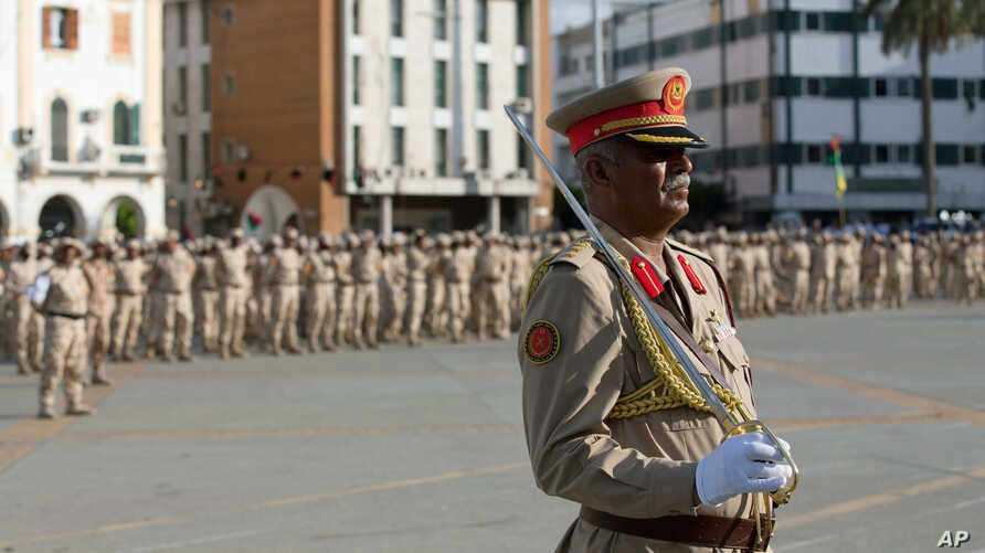 A Libyan Army commander leads a parade to celebrate the 75th anniversary of the establishment of the Libyan Army in Martyrs Square, Tripoli, Aug 13, 2015.