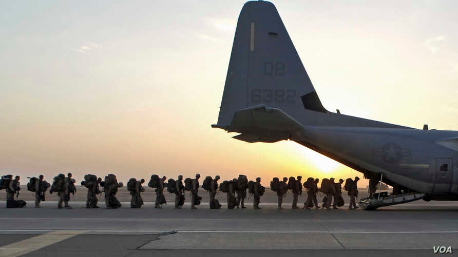 Marines and sailors with Marine Expeditionary Brigade – Afghanistan load onto a KC-130 aircraft on the Camp Bastion flightline, Oct. 27, 2014. The Marine Corps ended its mission in Helmand province, Afghanistan, the day prior and all Marines, sailors