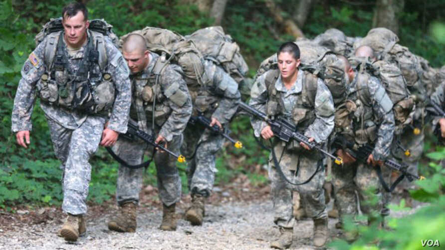U.S. Army Ranger candidate soldiers, burdened with heavy packs and weapons, conduct Mountaineering training during the Ranger Course on Mount Yonah in Cleveland, Ga., July 14, 2015.