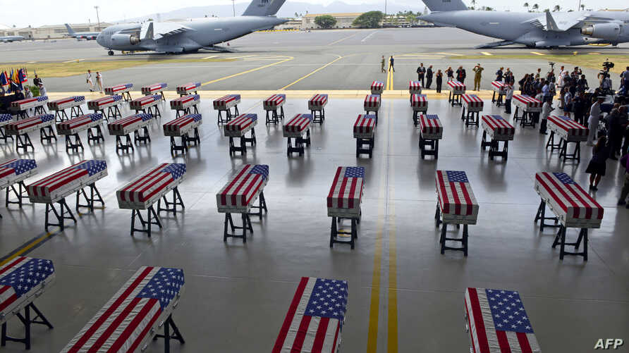 Flag draped transfer cases with the remains of American soldiers repatriated from North Korea are seen during a repatriation ceremony after arriving to Joint Base Pearl Harbor-Hickam, Honolulu, Hawaii, on August 1, 2018.
