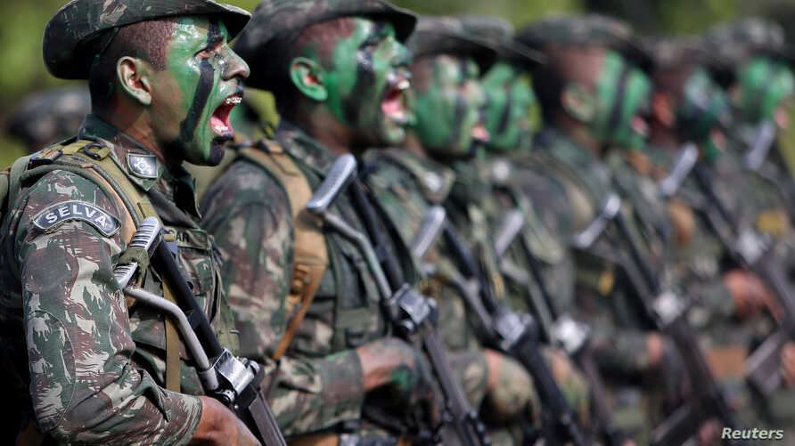 Brazilian Army soldiers react at the border with Colombia during a training to show efforts to step up security along borders, in Vila Bittencourt, Amazon State, Brazil, Jan. 18, 2017.