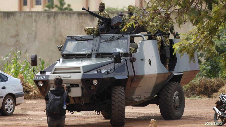 Presidential guard soldiers are seen on an armored vehicle at Laico hotel in Ouagadougou, Burkina Faso, Sept. 20, 2015.