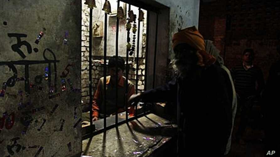 """A man buys illegal """"country liquor,"""" also known as """"hooch,"""" in Allahabad, India, Dec. 15, 2011."""