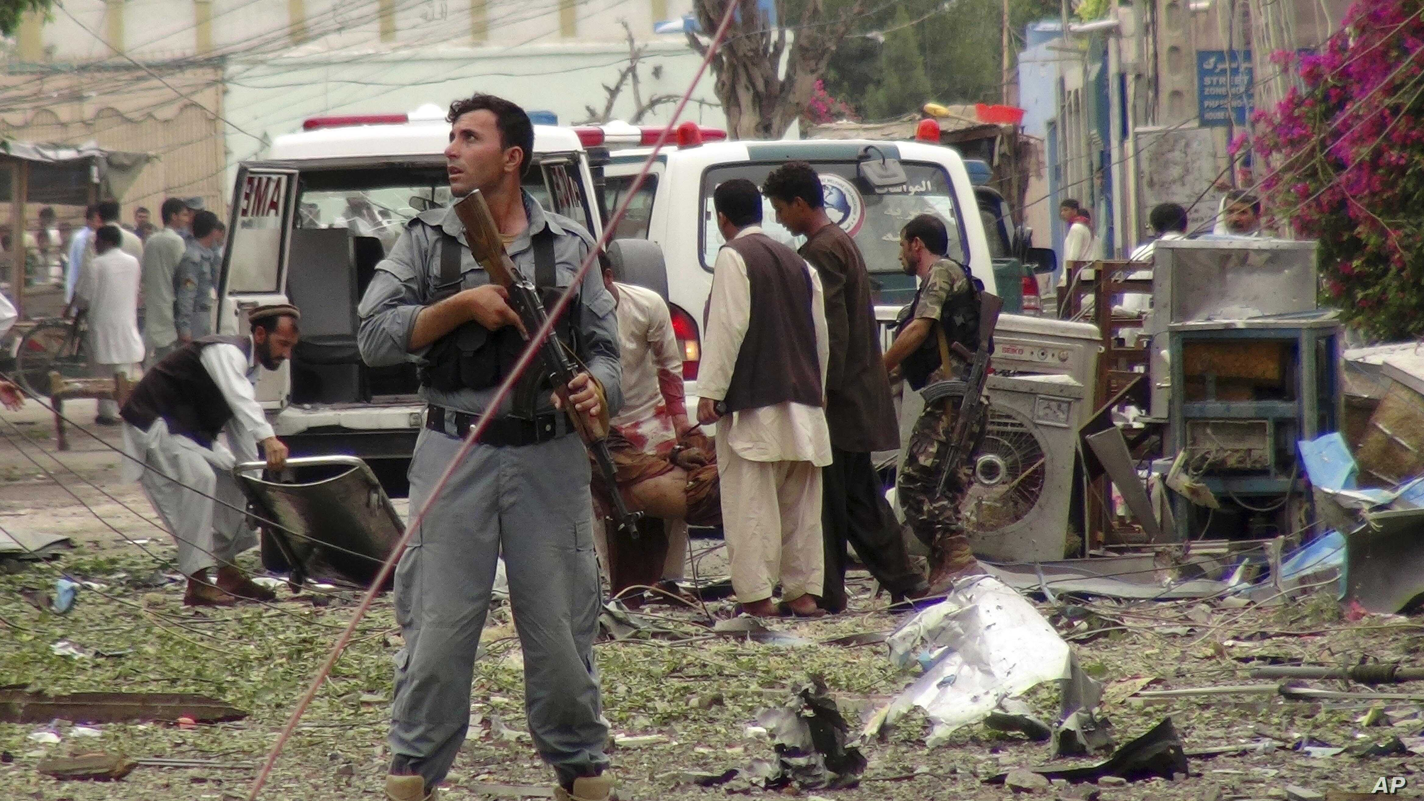Security officials conduct investigation at the scene of suicide bomb attacks in Jalalabad, Afghanistan, Aug. 3, 2013.