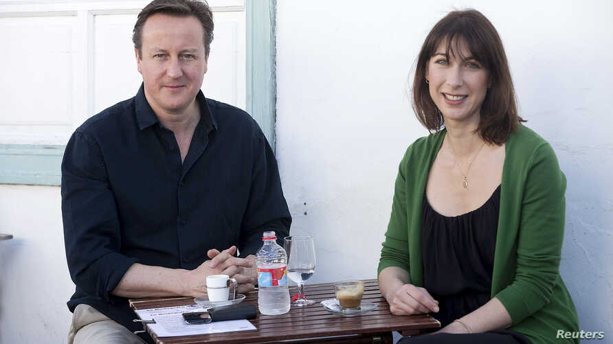 Britain's Prime Minister David Cameron and his wife Samantha during their holiday on the Spanish Canary island of Lanzarote, April 13, 2014.