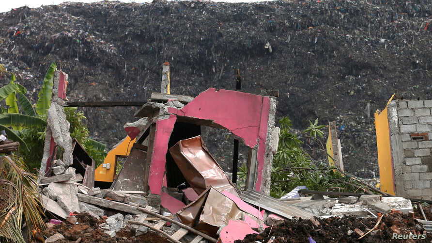 A damaged house is seen during a rescue mission after a garbage dump collapsed and buried dozens of houses in Colombo, Sri Lanka, April 15, 2017.