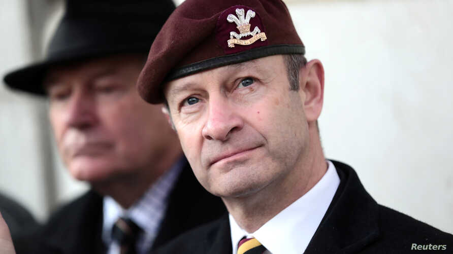 """FILE - Then-UKIP leader Henry Bolton joins protesters from """"Justice for Northern Ireland Veterans"""" as they demonstrate in Horse Guards Parade in Westminster in London, Feb. 3, 2018."""