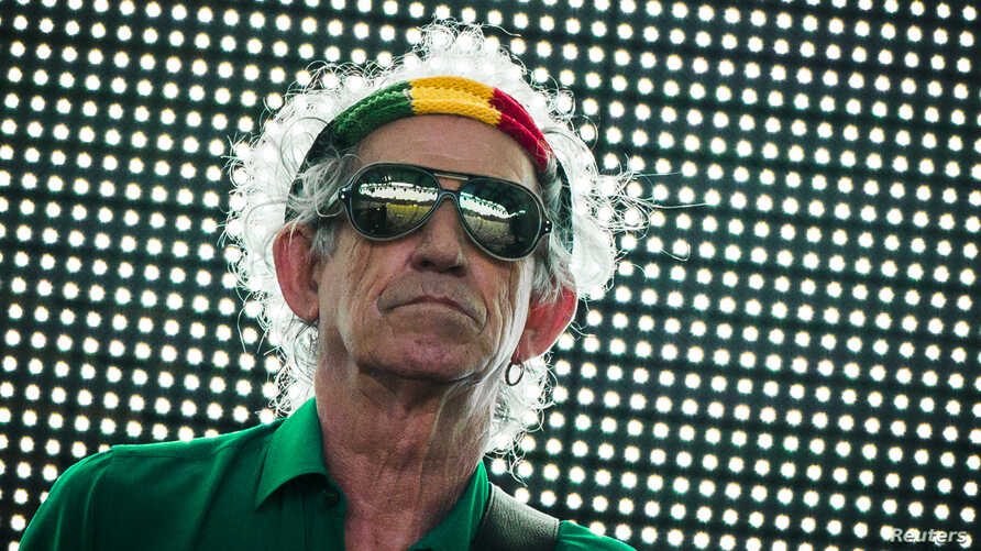 """FILE - Keith Richards of the Rolling Stones performs during their """"14 on Fire"""" show at Waldbuehne in Berlin, June 10, 2014."""