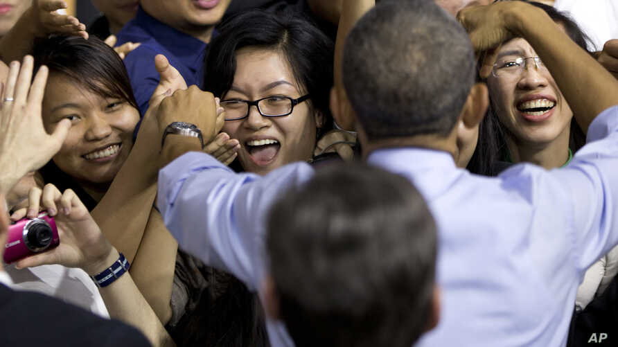 President Barack Obama greets people in the audience after speaking to Vietnamese young people during the Young Southeast Asian Leaders Initiative town hall meeting at the GEM Center in Ho Chi Minh City, Vietnam, May 25, 2016.