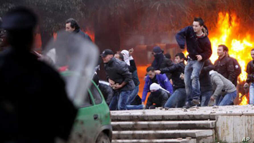 Opposition protesters throw stones at police after a pro-opposition rally in Tirana, Albania, 21 Jan 2011