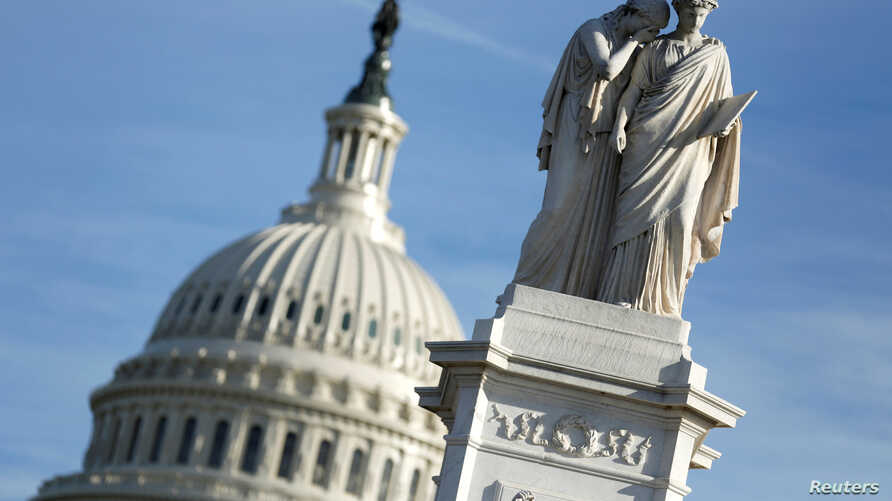 The figures of Grief and History stand atop the Peace Statue near the U.S. Capitol, Jan. 20, 2018. President Donald Trump and the U.S. Congress failed to reach a deal on funding federal agencies in Washington.