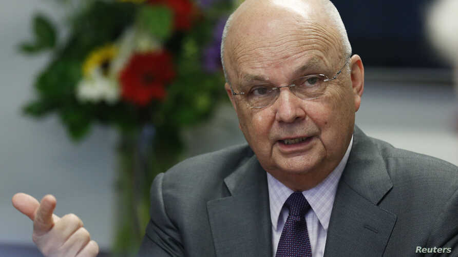 FILE - Former NSA/CIA Director Michael Hayden talks during a Reuters CyberSecurity Summit in Washington, May 12, 2014.