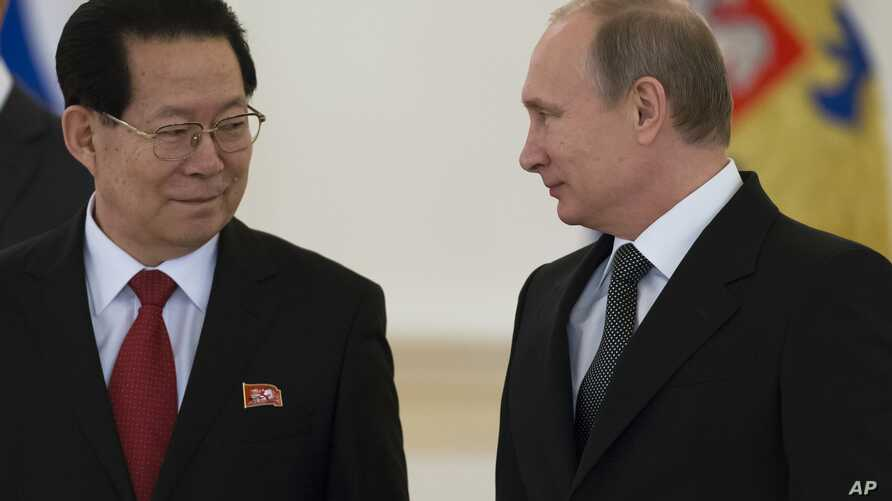 """FILE -  North Korea's ambassador to Russia, Kim Hyun Joon, pictured with Russian President Vladimir Putin in November 2014, says """"it is well-known that the DPRK is already a nuclear state in both content and form."""""""