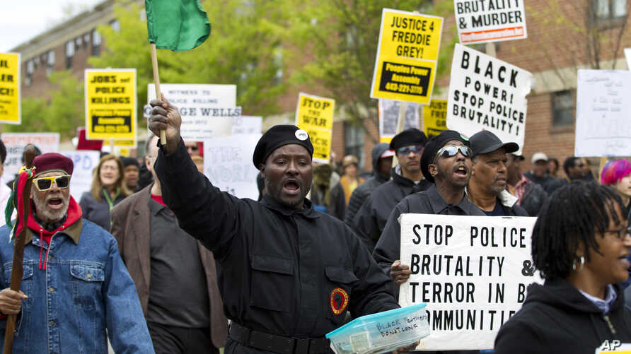 Demonstrators protest in the streets as they march for Freddie Gray to Baltimore's City Hall, in Baltimore, April 25, 2015.