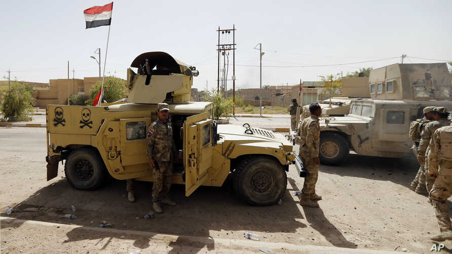 Iraqi security forces enter central Fallujah after fight against the Islamic State militants, Iraq, June 17, 2016.