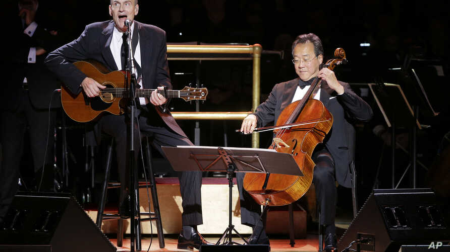 James Taylor (L) performs with cellist Yo-Yo Ma during Carnegie Hall's 125th Anniversary Concert, May 5, 2016, in, New York.