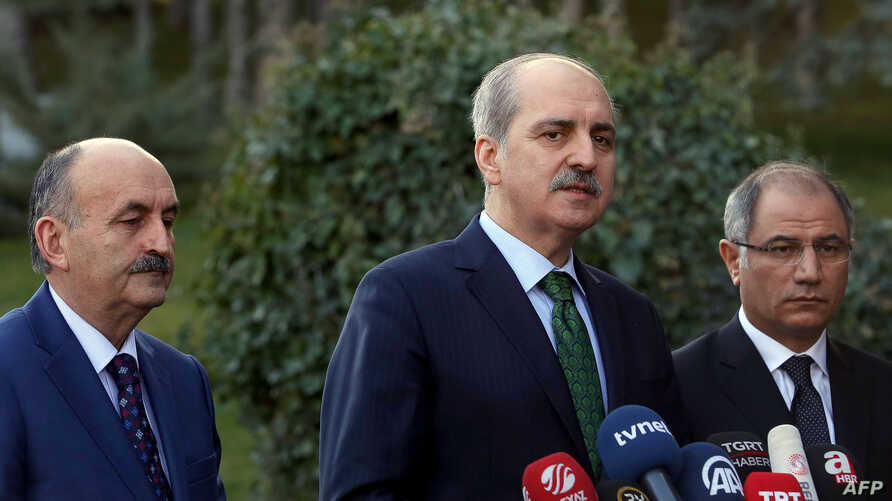 Turkish Deputy Prime Minister Numan Kurtulmus (C) gives a statement flanked by Turkish Interior Minister Efkan Ala (R) and Turkish Health Minister Mehmet Muezzinoglu (L) after a security meeting at the Cankaya Palace in Ankara, Jan. 12, 2016,