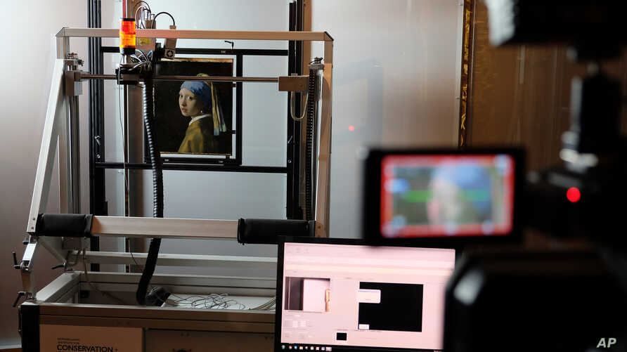"""A Macro XRF scanner is used to study in minute detail the surface of Johannes Vermeer's masterpiece """"Girl with a Pearl Earring"""", at the Mauritshuis museum in The Hague, Netherlands, Feb. 26, 2018."""