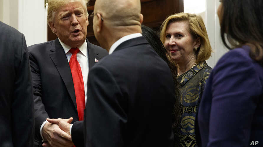 Deputy National Security Adviser Mira Ricardel, right, watches as President Donald Trump arrives for a Diwali ceremonial lighting of the Diya in the Roosevelt Room of the White House, Nov. 13, 2018, in Washington.