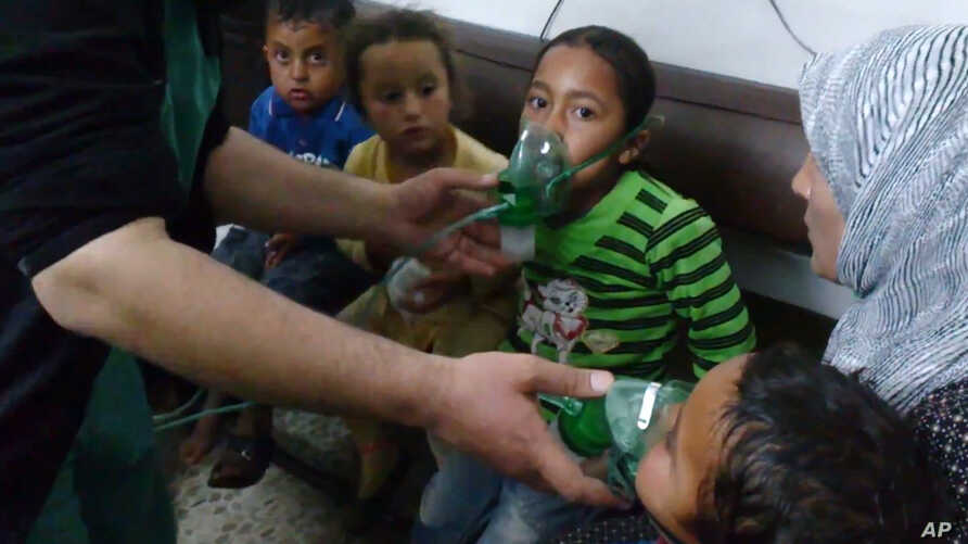 In this image taken from video obtained from the Shaam News Network, posted on April 16, 2014, an anti-Bashar Assad activist group, which has been authenticated based on its contents and other AP reporting, children are seen receiving oxygen in Kfar