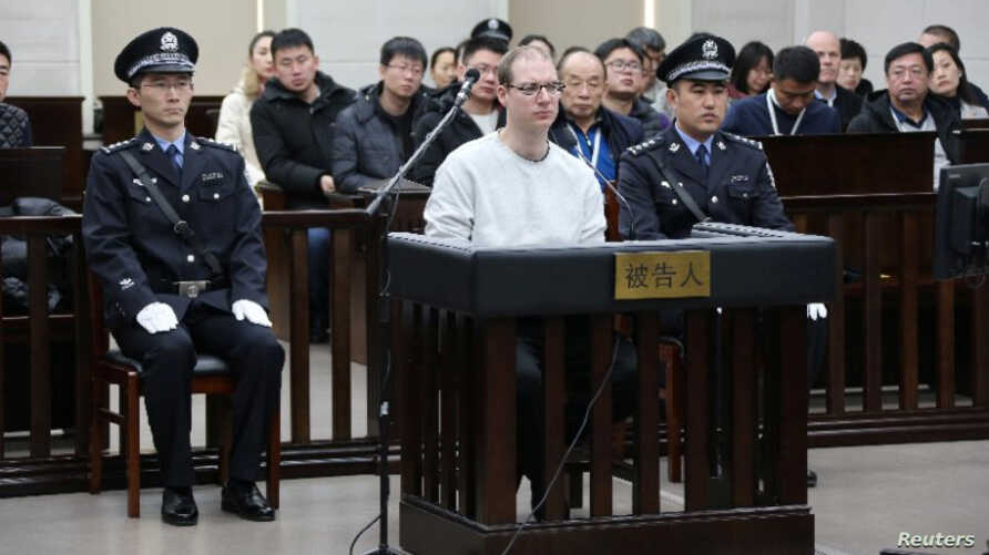 Canadian Robert Lloyd Schellenberg appears in court for a retrial of his drug smuggling case in Dalian, Liaoning province, China, Jan. 14, 2019.