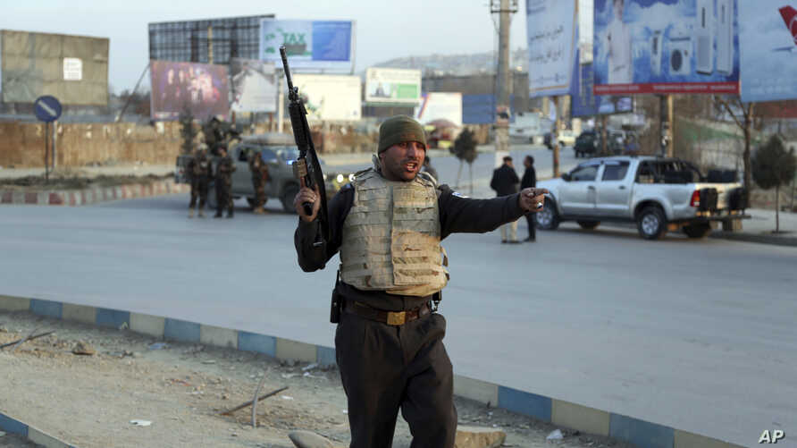 Afghan security forces arrive at the site of an explosion and attack by gunmen, in Kabul, Afghanistan, Dec. 24, 2018.