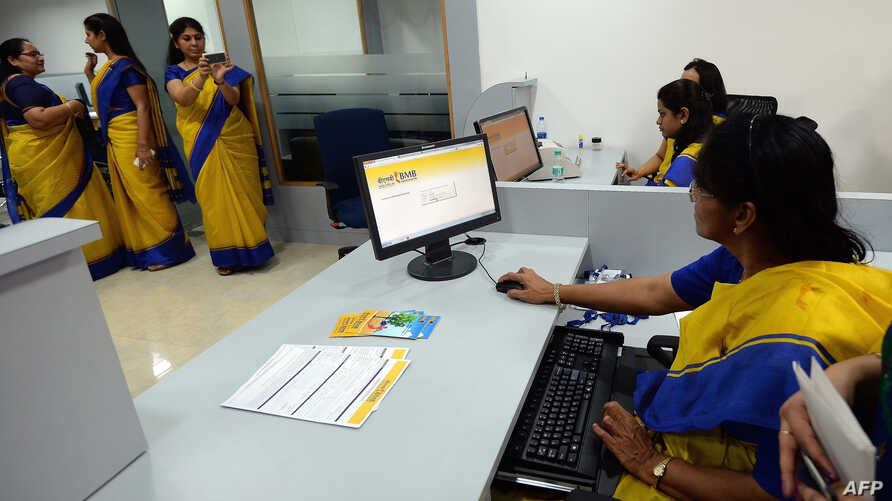 An all-female bank staff are pictured at their terminals during the inauguration of the first branch of the Bharatiya Mahila Bank (BMB), India's first state owned women's bank, in Mumbai, Nov. 19, 2013.