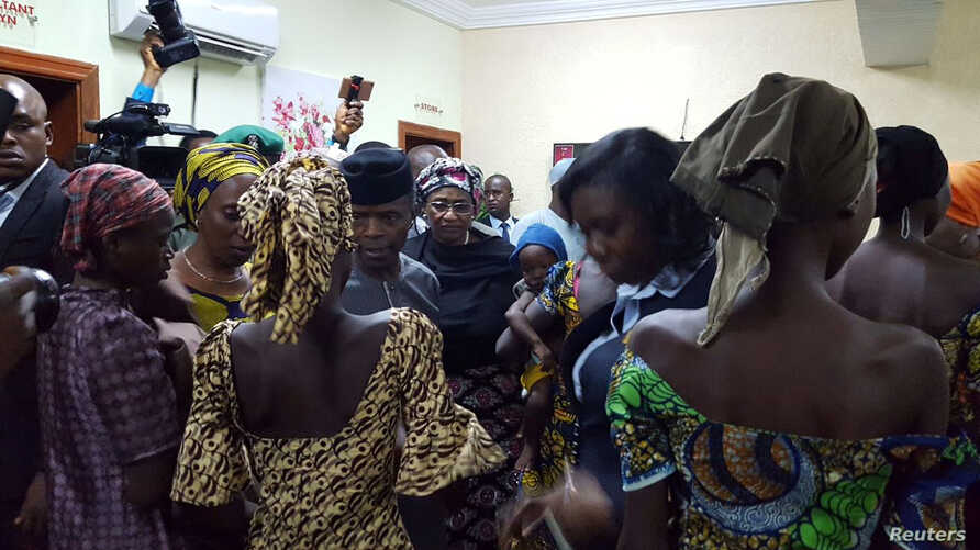 Some of the 21 Chibok school girls released are seen during a meeting with Nigeria's Vice President Yemi Osinbajo in Abuja, Nigeria, Oct. 13, 2016.