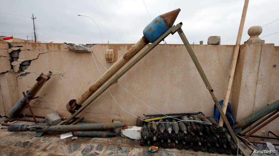 Weapons and ammunition belonging to Islamic State militants are seen in the town of Bashiqa, east of Mosul, Iraq, Dec. 14, 2016.