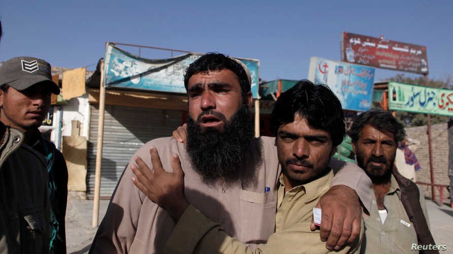 Relatives of police cadets wait for word outside the Police Training Center after an attack on the center in Quetta, Pakistan Oct. 25, 2016.