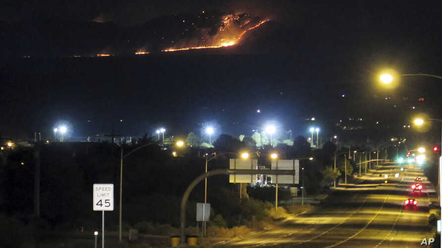 In this June 8, 2017 photo, the Dragoon fire is visible from just off Interstate 10, seen from Benson, Ariz.